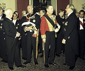 Diplomatic uniform - Diplomatic reception, West Germany, 1961; the Danish ambassador wears a red diplomatic uniform, the British ambassador a dark one.