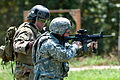 Defense.gov News Photo 110801-A-3108M-001 - An Army instructor works with an Army paratrooper on close quarter marksmanship during field training at Fort Bragg N.C. on Aug 1 2011. The.jpg