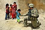 Defense.gov News Photo 110810-F-FT240-288 - U.S. Air Force Senior Airman Sarah Baker greets children during a security halt in Qalat City Afghanistan on Aug. 10 2011. Baker is assigned to.jpg