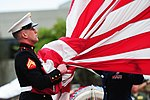 Defense.gov News Photo 110916-F-WA575-460 - A United States Marine takes the American flag into his hands before folding it with the flag detail at the POW MIA Remembrance Day retreat ceremony.jpg