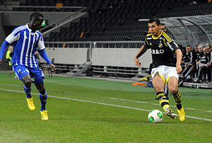 Helsingin Jalkapalloklubi - Nabil Bahoui of AIK taking on HJK winger Demba Savage during a friendly match between the two teams in March 2013.