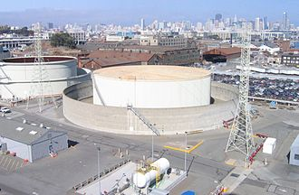 Potrero Generating Station - One of three liquid fuel storage vessels at Potrero.  The skyline of the City of San Francisco is visible in the background.