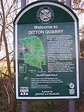 "A photograph of a sign saying ""Welcome to Ditton Quarry"" and explaining the history of the nature reserve and containing an outline map of the walks available to visitors"