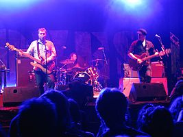 Doves performing live in 2009. From left to right: Jimi Goodwin, Andy Williams, and Jez Williams.