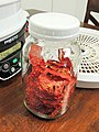 Dried tomatoes conditioning in mason jar.jpg