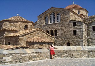 Panagia Ekatontapiliani - The church with a woman in front for comparison of scale.