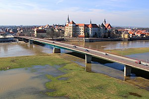 Bundesstraße 87 - B87, Bridge over the river Elbe at Torgau with the river in flood. Hartenfels Castle is in the background.