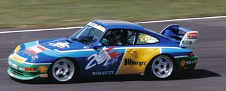 Emmanuel Collard - Collard driving in the Porsche Supercup in 1995. His car's livery reflects his role as the Benetton Formula One team's test driver.