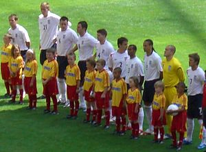 Gary Neville - Neville (wearing No.2) lining up for England against Paraguay at the 2006 FIFA World Cup.