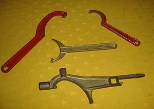 Hydrant wrench - Several tricoise wrenches; the red ones at the top are in vehicles, the yellow in the middle hang at the fire belts, the bottom one is a polycoise.