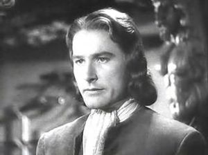 Cropped screenshot of Errol Flynn from the tra...