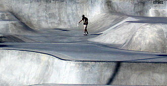 Etnies Skatepark of Lake Forest - Skateboarder rides the flow course