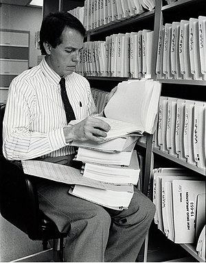 Food and Drug Administration - Medical Officer Alexander Fleming, M. D., examines a portion of a 240-volume new drug application around the late 1980s. Applications grew considerably after the efficacy mandate under the 1962 Drug Amendments.