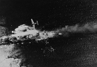 Japanese destroyer Tachikaze (1921) - A VF-9 F6F over the stranded Tachikaze during Operation Hailstone, February 1944.