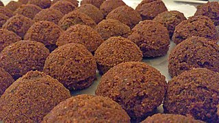 Falafel traditional Middle Eastern food: deep-fried balls of ground chickpeas or fava beans