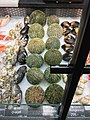 Fiskebryggen, Mathallen, Fishmarket, Bergen, Norway 2018-03-18. Modiolus modiolus (o-skjell), sea urchin (kråkebolle), Buccinum undatum (kongesnegle, kongsnegl), etc. displayed for sale at Fjellskål sea food store.jpg