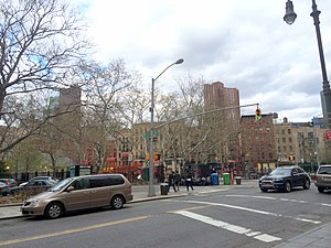 Five Points, Manhattan - The former site of the notorious Five Points tenement, as seen in 2014. Worth Street is in the foreground; Baxter Street, can be seen from the left. Columbus Park is to the right, in the background.