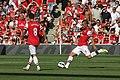 Flickr - Ronnie Macdonald - Mikel Arteta ^ Lukas Podolski.jpg