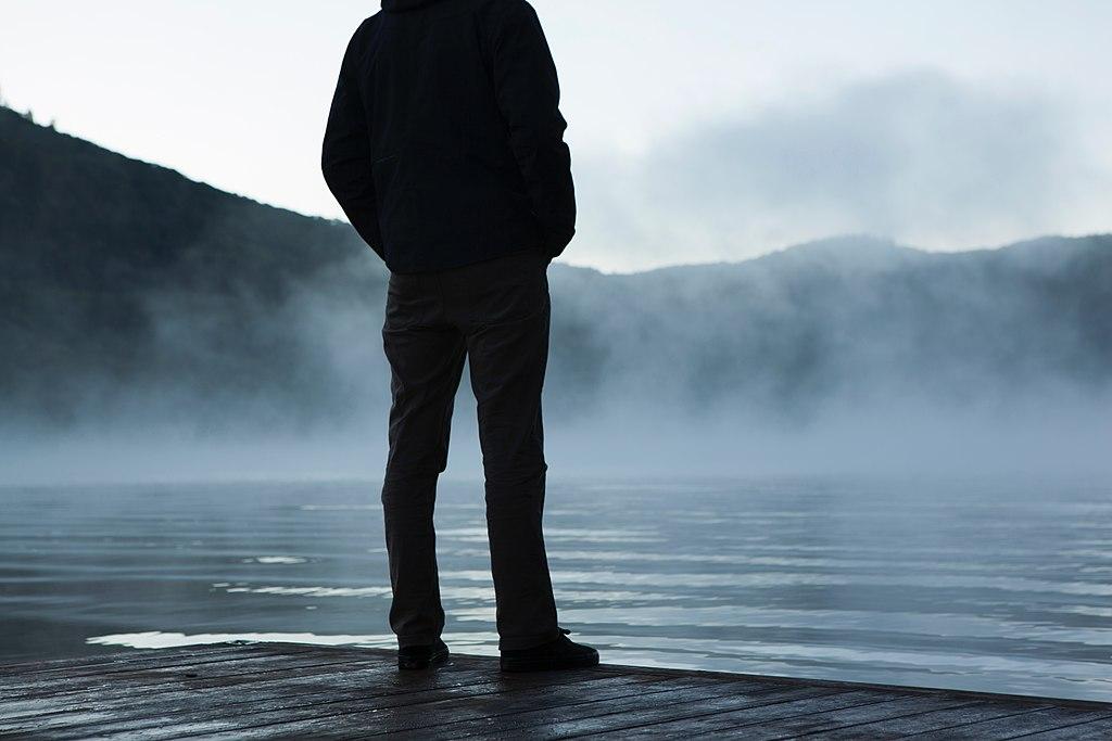 Fog surrounding standing man