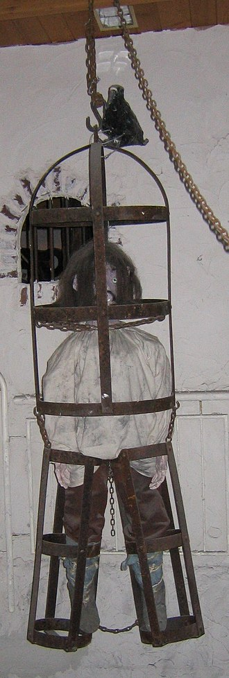 Gibbeting - A gibbet with a dummy inside