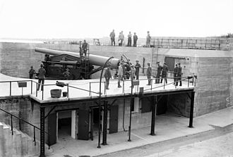 Fort Hamilton - In June 1908, the 10th Company of the 13th Artillery District, NYNG (later the 245th Coast Artillery) loads a 10-inch gun at Fort Hamilton