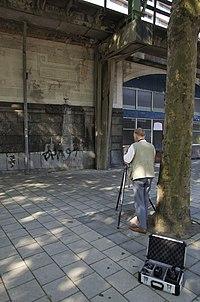 Fotograaf IJsbrand Heins aan het werk - Rotterdam - 20333837 - RCE.jpg