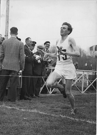 International Cross Country Championships - Frank Sando crossing the line to win the 1957 edition of the championships