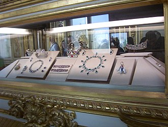 French Crown Jewels - The Côte-de-Bretagne red spinel with the set of Queen Marie Amélie to the left, the bracelets and diadem of the Duchess of Angoulême in the centre and upper right and, between them, the set of Empress Josephine.