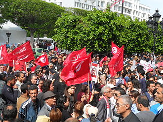 2013–14 Tunisian political crisis - Popular Front gathering in April 2013. Some are carrying posters demanding justice for Chokri Belaid.