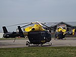 G-SUSX With G-GMPX Two Explorer MD900 Helicopters (25166253429).jpg