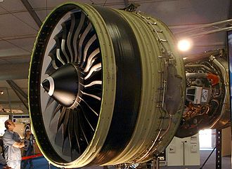 General Electric GE90 - A person standing in front of a GE90-115B engine