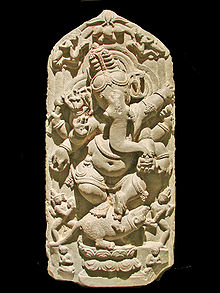 Ganesh, elephant-headed God, dancing on a mouse