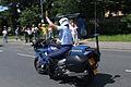 Gendarmerie motor officer raising arm in traffic.jpg