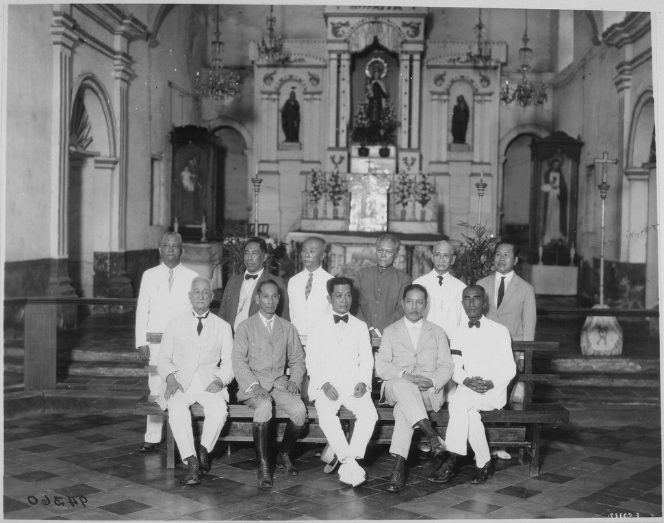 General Aguinaldo (seated, center) and ten of the delegates to the first Assembly of Representatives that passed the Con - NARA - 530993