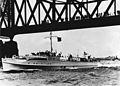 German motor-torpedo boat S13 passing under a bridge in the 1930s (NH 91615).jpg