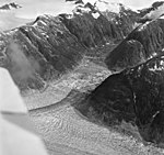Gilkey Glacier, terminus of branch of valley glacier with trimline and hanging glaciers on the mountainsides, August 27, 1969 (GLACIERS 6325).jpg