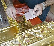 WATER GILDING: A gilders tip used to apply 22 Karat gold leaf to a frame