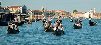 Gondoliers on the Grand Canal Gondola convoy, Grand Canal, Venice.jpg