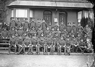 Group portrait of fifty or so soldiers