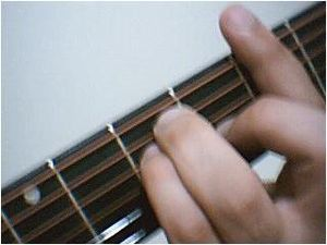 "Barre chord - A barre chord (""E Major shape""), with the index finger used to bar the strings."