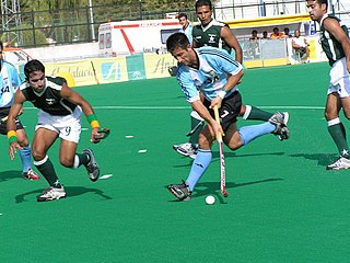 Field hockey Team sport version of hockey played on grass or turf with sticks and a round ball