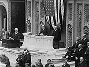 Harding addresses the House of Representatives, Coolidge and Gillett seated behind.