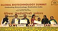"""Harsh Vardhan releasing the publication at the inauguration of the Global Biotechnology Summit -""""Destination India"""", in New Delhi. The Minister of State for Commerce & Industry (Independent Charge), Smt. Nirmala Sitharaman.jpg"""