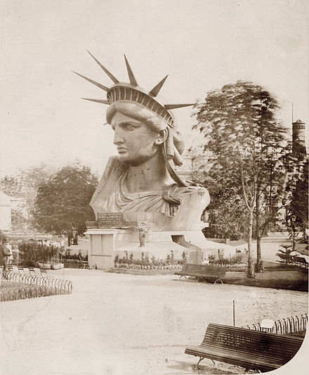 The statue's head on exhibit at the Paris World's Fair, 1878 Head of the Statue of Liberty on display in a park in Paris.jpg