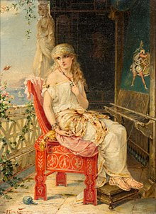 A woman sitting on a chair on a balcony