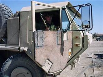 "Improvised vehicle armour - ""Hillbilly"" scrap armor plate on door of U.S. Army 8x8 HEMTT truck at a base at Ar-Ramadi, Iraq."