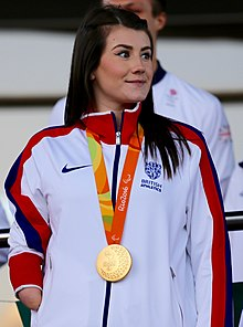 Hollie Arnold with Paralympic gold medal.jpg
