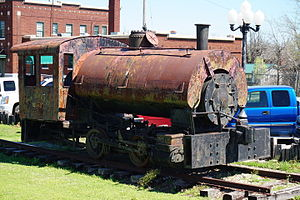 Davenport Locomotive Works - Davenport-built DkW OZA 0-4-0T No. 1907 on display outside the Frisco Depot Museum in Hugo, Oklahoma