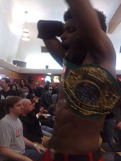 Human Tornado with the PWG World Championship belt