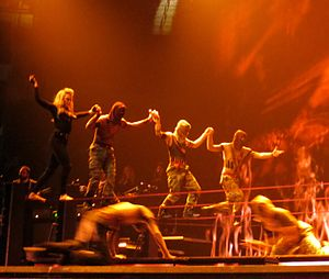 "Hung Up - Madonna and her dancers do a slacklining routine during the performance of ""Hung Up"" on The MDNA Tour (2012)."